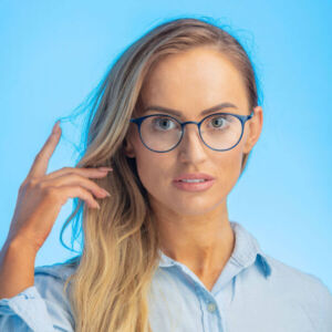 Blonde lady modelling a pair of blue round acetate glasses.