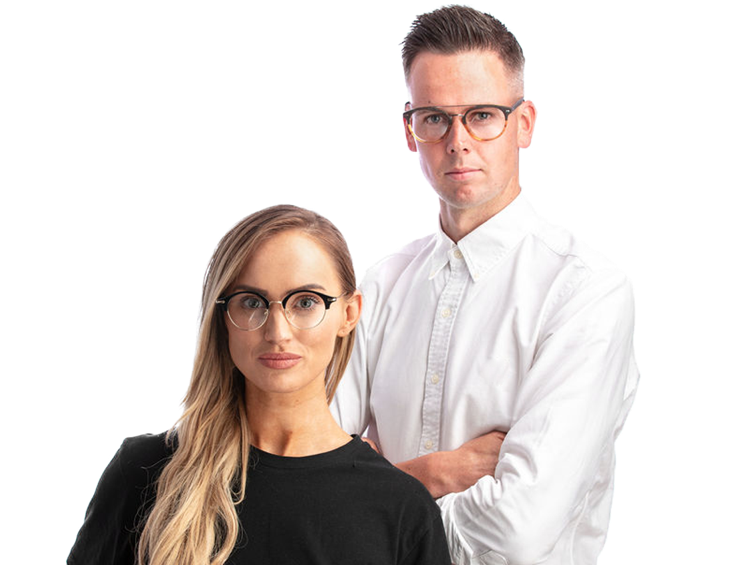 A blond woman in black tshirt wearing half rim round glasses standing beside a man in a white shirt wearing black and orange round glasses